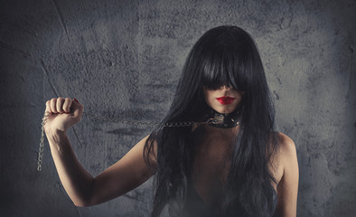 Sensual provocation of a sexy bdsm woman with chained neck