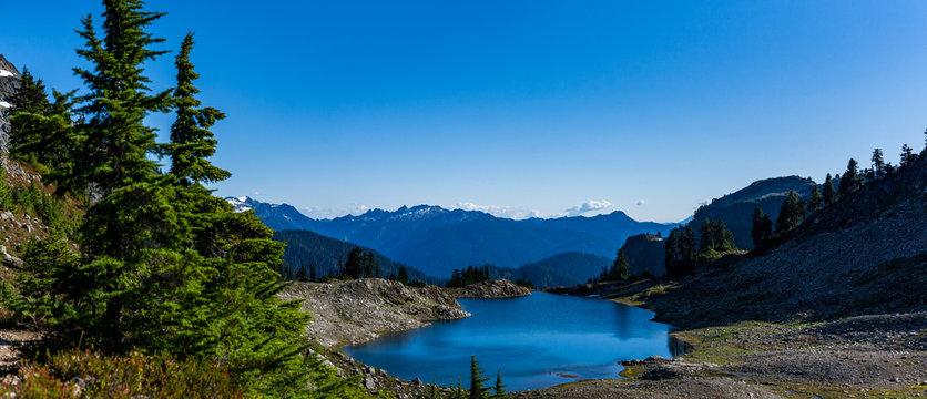 Beautiful wide shoot of snowy peak along the trail towards Mount Baker, Washington, USA. Whatcom county.