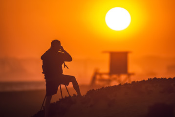 Photographer shooting sunset