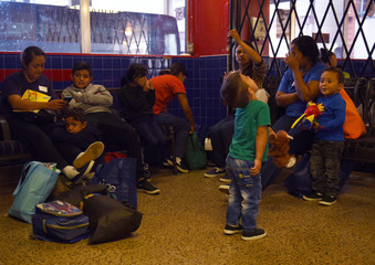 Undocumented immigrants wait at a bus station in San Antonio