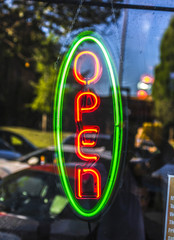 Green and red open sign neon
