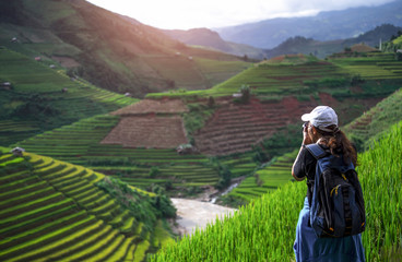 Photographer is taking a picture of sunset in World heritage  rice terraces