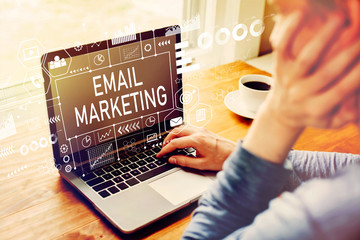 Email marketing with man using a laptop computer