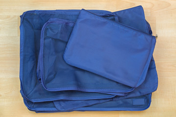 Different blue cube bags, set of travel organizer to help packing luggage easy