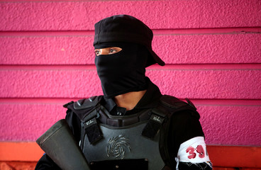 A member of Nicaragua's Special Forces stands guard during clashes with anti-government protesters in the indigenous community of Monimbo in Masaya, Nicaragua