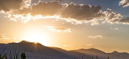 Sun setting behind beautiful Utah mountains