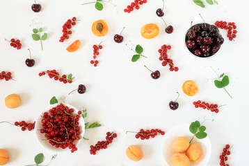 Summer yummy fruits, berry background, food colors pattern  from apricots, cherries, red currant  on a white background. Flat lay. Top view. Copy space