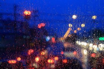 street light bokeh. blur traffic light behind windshield. rain
