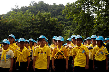 "Children volunteers arrive to clear the campsite of the rescue mission for the 12 boys of the ""Wild Boars"" soccer team and their coach, near the Tham Luang cave complex, in the northern province of Chiang Rai"