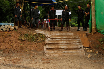 "Police stand guard outside the Tham Luang cave complex, after the rescue mission for the 12 boys of the ""Wild Boars"" soccer team and their coach, in the northern province of Chiang Rai"