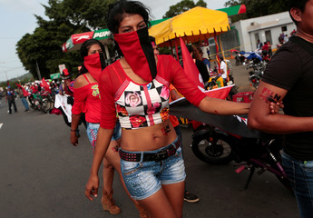 "A supporter of Nicaragua's President Daniel Ortega takes part in celebrations to mark the 39th anniversary of the ""Repliegue"" (Withdrawal) in Masaya"