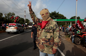 "A pro-government supporter takes part in celebrations to mark the 39th anniversary of the ""Repliegue"" (Withdrawal) in Masaya"