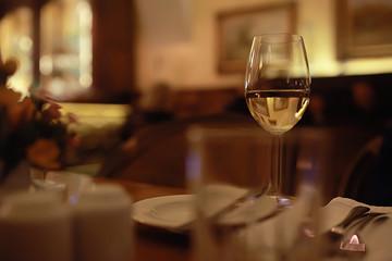 glass of white wine in the restaurant / white wine in the interior of the restaurant a table with glasses of wine, a romantic summer