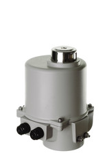Small electric drive (actuator) gray colour for valves.  . Еxplosion-proof. Wooden and fabric background.. Wooden and fabric background.. Caption: open, closed.