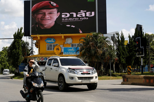 """A board showing """"R.I.P. Samarn Kunan, A hero who sacrificed his life at Tham Luang"""", is seen after a mission to save 12 soccer boys and their coach, in Chiang Rai"""