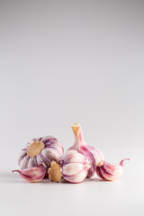 Garlic Cloves and Bulbs over white background