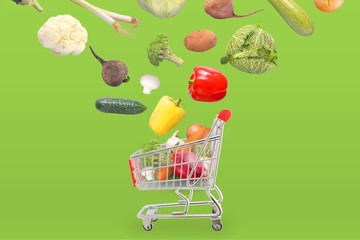 Organic vegetables fall in basket. Green background.