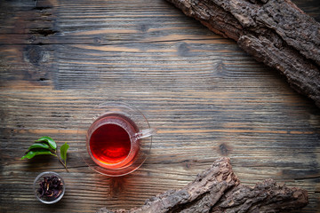 Cup of tea with fresh tea leaves