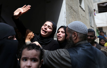 Relatives of Palestinian Shurab, 18, mourn during his funeral in Khan Younis in the southern Gaza Strip