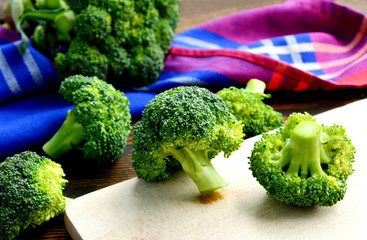 Broccoli full of antioxidant and many vitamin on wooden board.