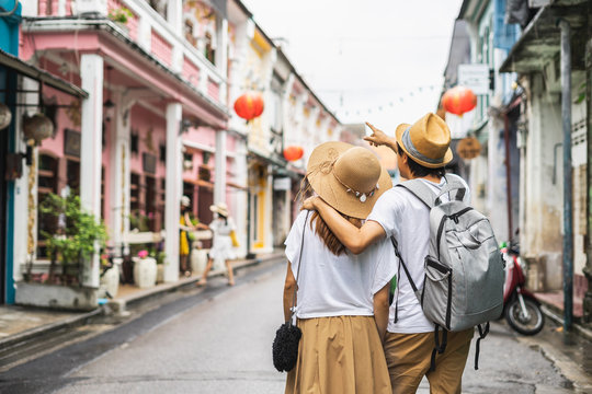 Young couple traveler walking at Phuket old town in Thailand