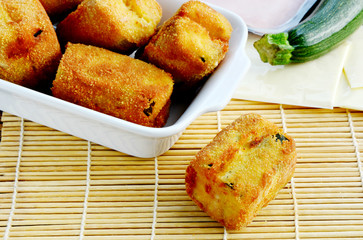 Simple vegetable Menu for children.  Breaded zucchini  fried with ham and cheese.