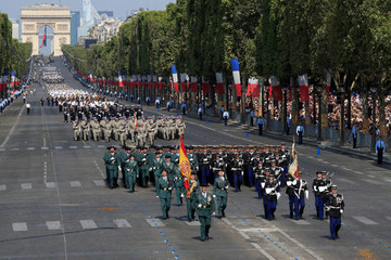 Members of Spain's Guardia Civil of Valdemoro march with French Gendarmes during the traditional Bastille Day military parade on the Champs-Elysees Avenue in Paris