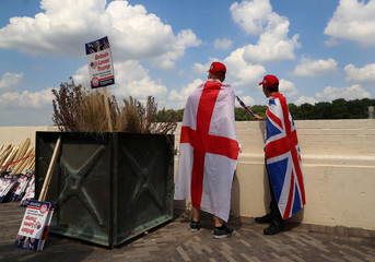 Demonstrators near the U.S. Embassy prepare for a pro-Trump rally, during the visit of U.S. President Donald Trump, in London