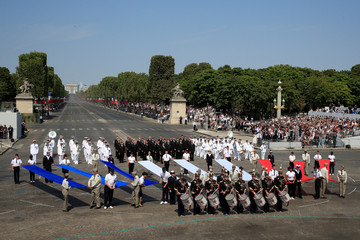 Drummers of the Republican Guard perform with members of the French Fleet and the French army choir during the traditional Bastille Day military parade on the Champs-Elysees Avenue in Paris