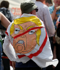Demonstrators prepare for a rally to protest against the visit of U.S. President Donald Trump to Britain, in Edinburgh