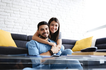 Portrait of Young Couple With Tablet PC Smiling
