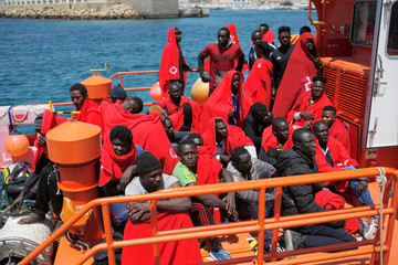 Migrants intercepted aboard three toy dinghies off the coast in the Strait of Gibraltar, are seen on a rescue boat upon arrival at the port of Tarifa