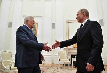 Russian President Vladimir Putin meets Palestinian President Mahmoud Abbas in Moscow