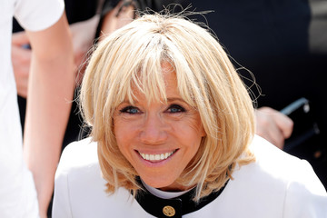 Brigitte Macron, the wife of French President Emmanuel Macron, poses after the traditional Bastille Day military parade on the Champs-Elysees in Paris
