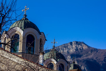 Street partial view of the domes of the Christian church in the town of Teteven, Bulgaria. One of the peaks of Stara Planina mountain could be seen in the back. Winter cold image
