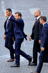French President Emmanuel Macron leaves after the traditional Bastille Day military parade on the Champs-Elysees Avenue in Paris