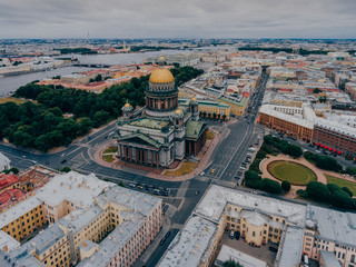 Beautiful view of St. Petersburg from height. St. Isaac`s Cathedral during cloudy day. Streets of Russian cities. Scenic view. Nice city.
