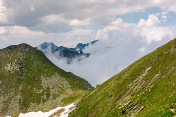 mountainous landscape on a cloudy summer day. beautiful nature scenery on high altitude. Capra peak, Fagaras mountains, Romania