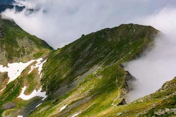 mountainous landscape on a cloudy summer day. beautiful nature scenery on high altitude. Fagaras mountains, Romania