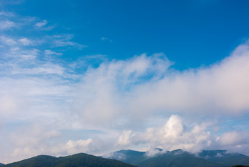 beautiful cloudscape over the mountains. lovely nature background