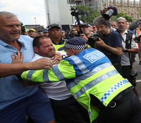 Supporters of English Defence League founder Tommy Robinson clash with police as they demonstrate in London
