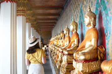Wall Mural - Tourist is visiting and sightseeing inside the Wat Arun temple in Bangkok, Thailand during holiday summer vacation time.