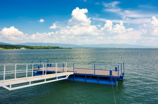 blue pier on Zemplinska Sirava lake. beautiful landscape of Slovakia with gorgeous cloudscape. Lovely place for vacation or weekend in summer