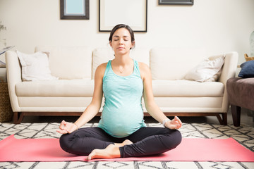 Expectant Mother Practicing Lotus Pose For Wellbeing Of Fetus