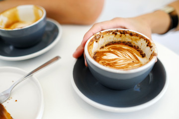 Hand holding coffee cup with copy space, top view, food and drink concept