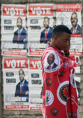 Zimbabwe's opposition party supporter gestures as he attends at a political rally at Sakubva stadium in Mutare, Zimbabwe