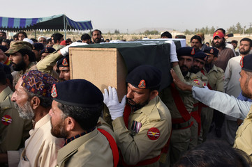 Army soldiers carry the casket of Siraj Raisani, provincial assembly candidate of Baluchistan Awami Party, who was killed in FridayÕs suicide attack during an election campaign meeting, for the funeral in Quetta,