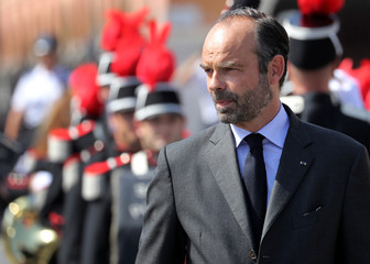 French Prime Minister Edouard Philippe reviews an honour guard of troops, in Nice