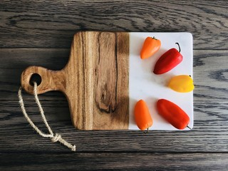Colorful Peppers on Wood Cutting Board