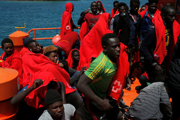 Migrants are seen on a rescue boat upon arrival at the port of Tarifa